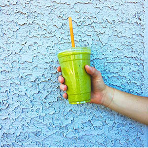 Smoothie being held, blue background